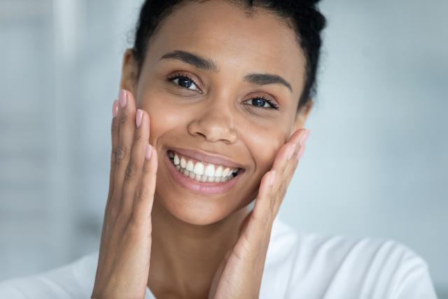 Woman showing off her skin after a chemical peel