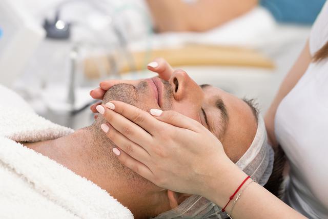 A man receiving a facial