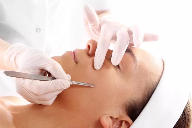 Woman undergoing dermaplaning treatment