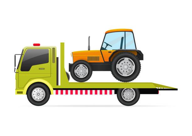 tractor on top of a flat bed truck