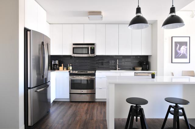 modern black and white kitchen using Ceramic Pro home coatings to keep surfaces clean and spotless
