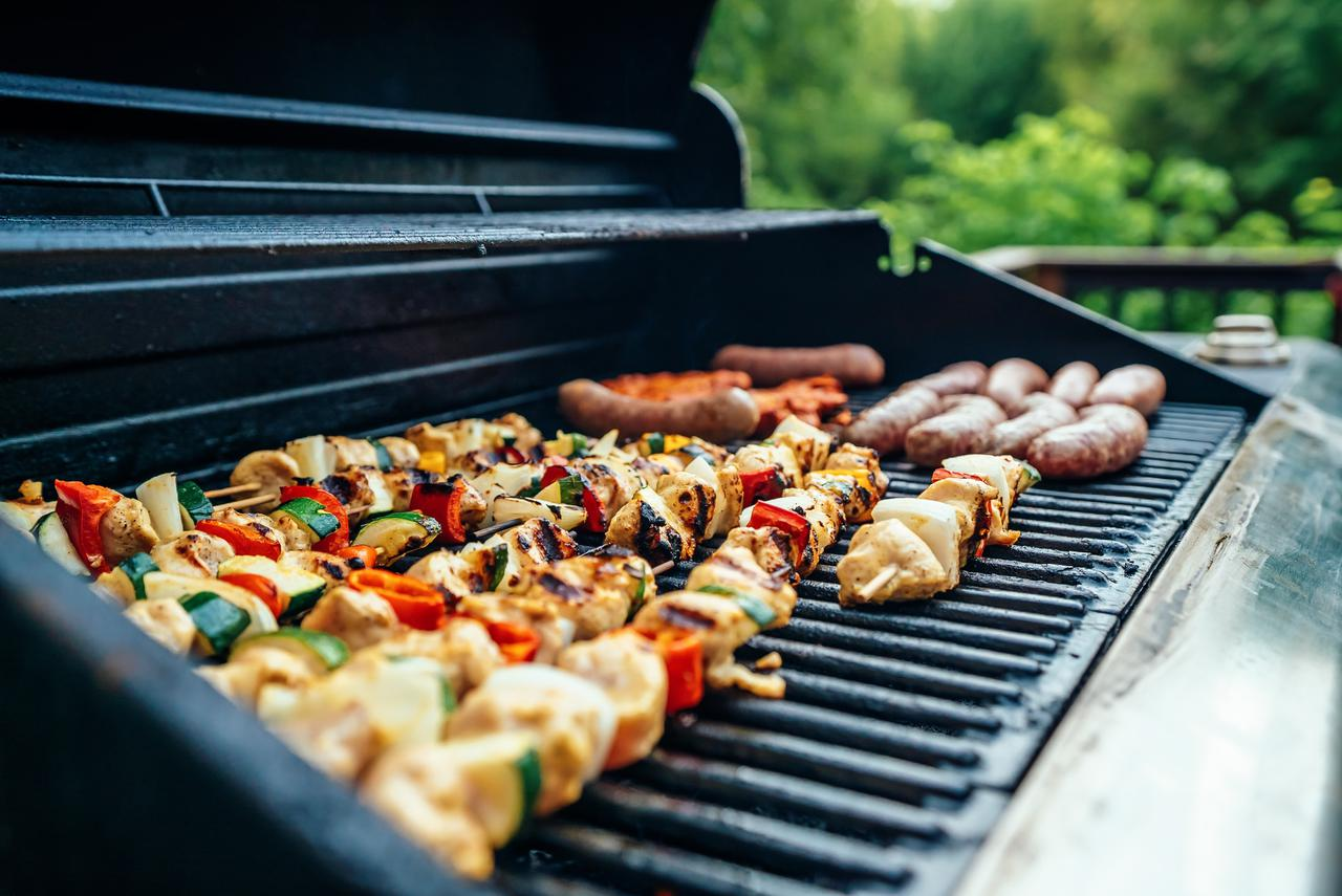 We joined a few friends for a Sunday afternoon cookout, and I found myself manning the grill. The colors caught my eye first, as I loved the contrast of the colorful kebabs with the blue of the grill and the green of the yard behind.