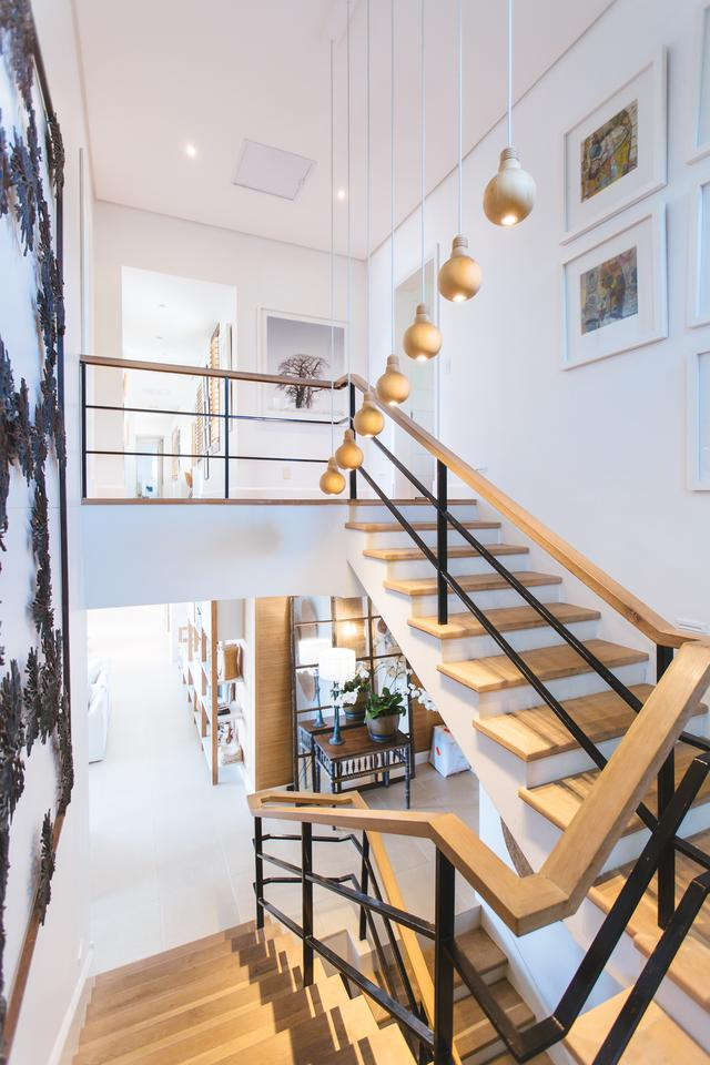 Image shows an interior of a home dominated by an open staircase. The photo accompanies a blog post on the advantages of working with a turnkey home builder.