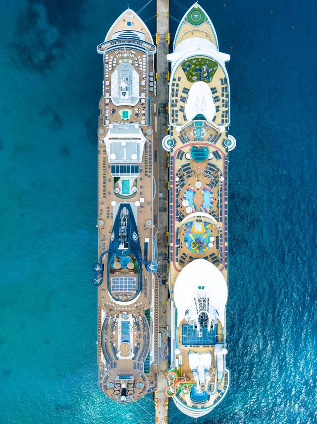 This photo was taken at the cruise port in Costa Maya, Mexico. The ship on the right is the Royal Caribbean Liberty of the Seas and the ship on the right is the MSC seaside. It is very cool to see the differences in the ships from above. Which ship would you prefer to be on?