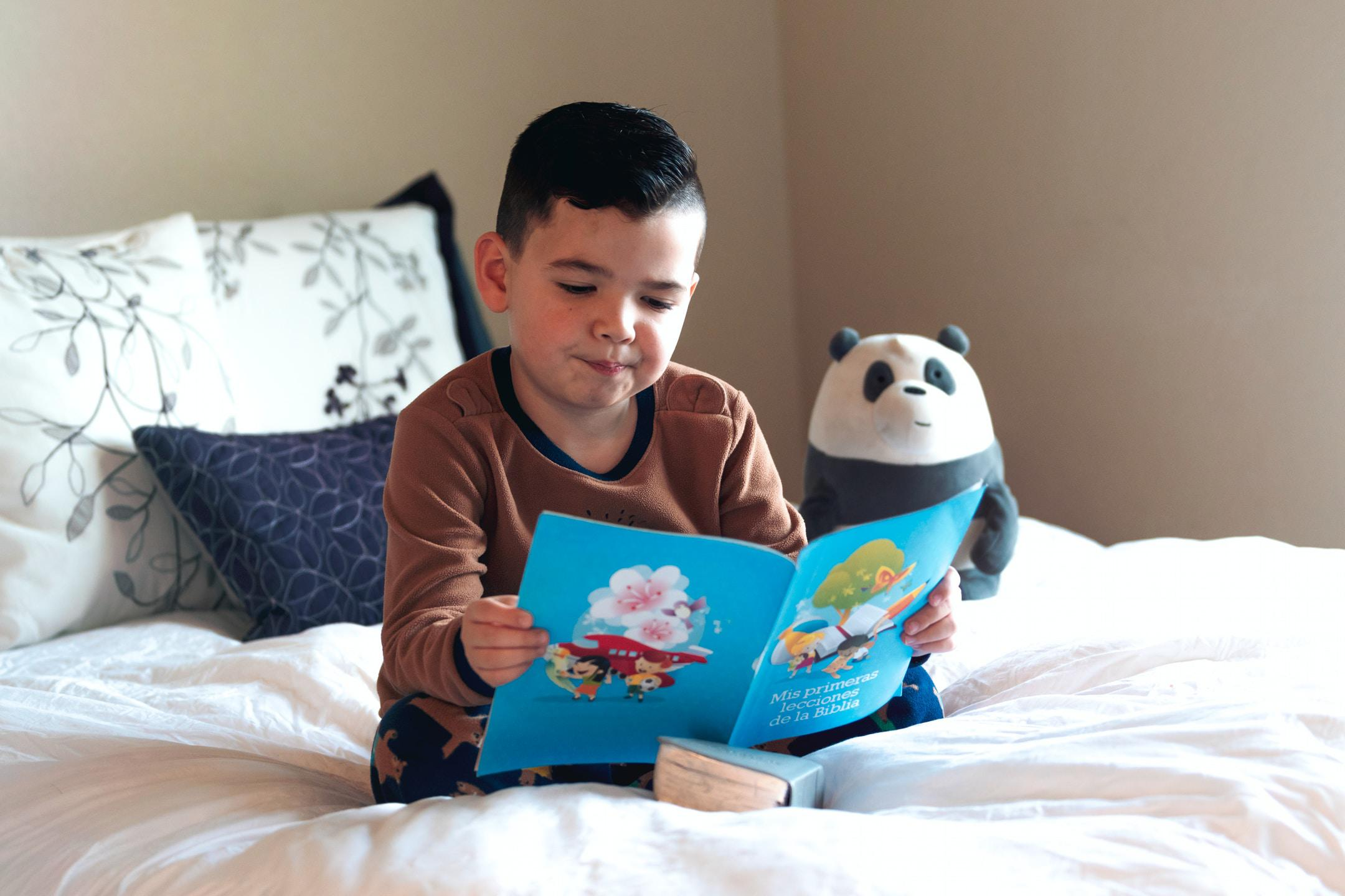 boy reading in his bed