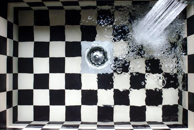 A clogged sink that needs professional drain cleaning.