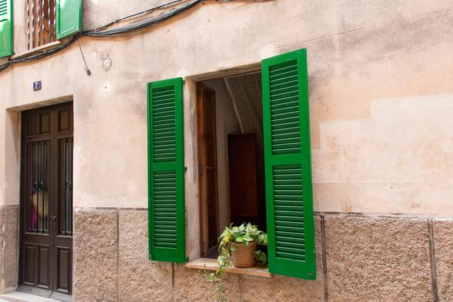 Green shutters on building