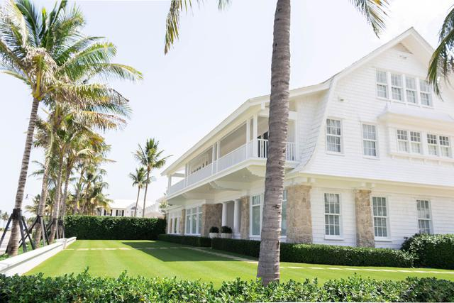 Image of an incredible home exterior because the owners used a paint contractor referral in Palm Beach, FL.