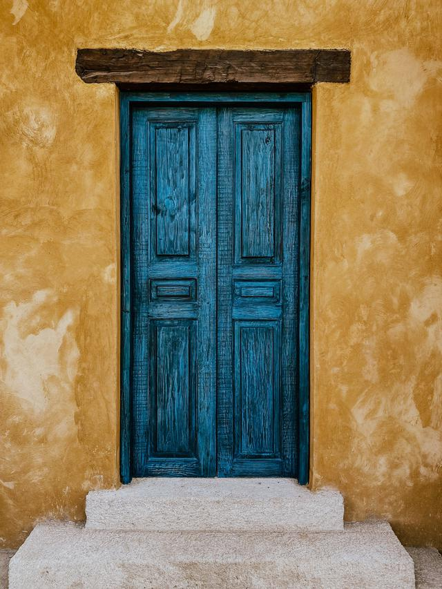 The Reason For Blister, Peeling, and Fading Of Exterior Doors Painted a Dark Color