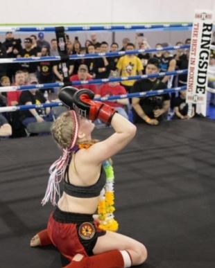 Image of woman compete in muay thai fights in Chicago, IL.