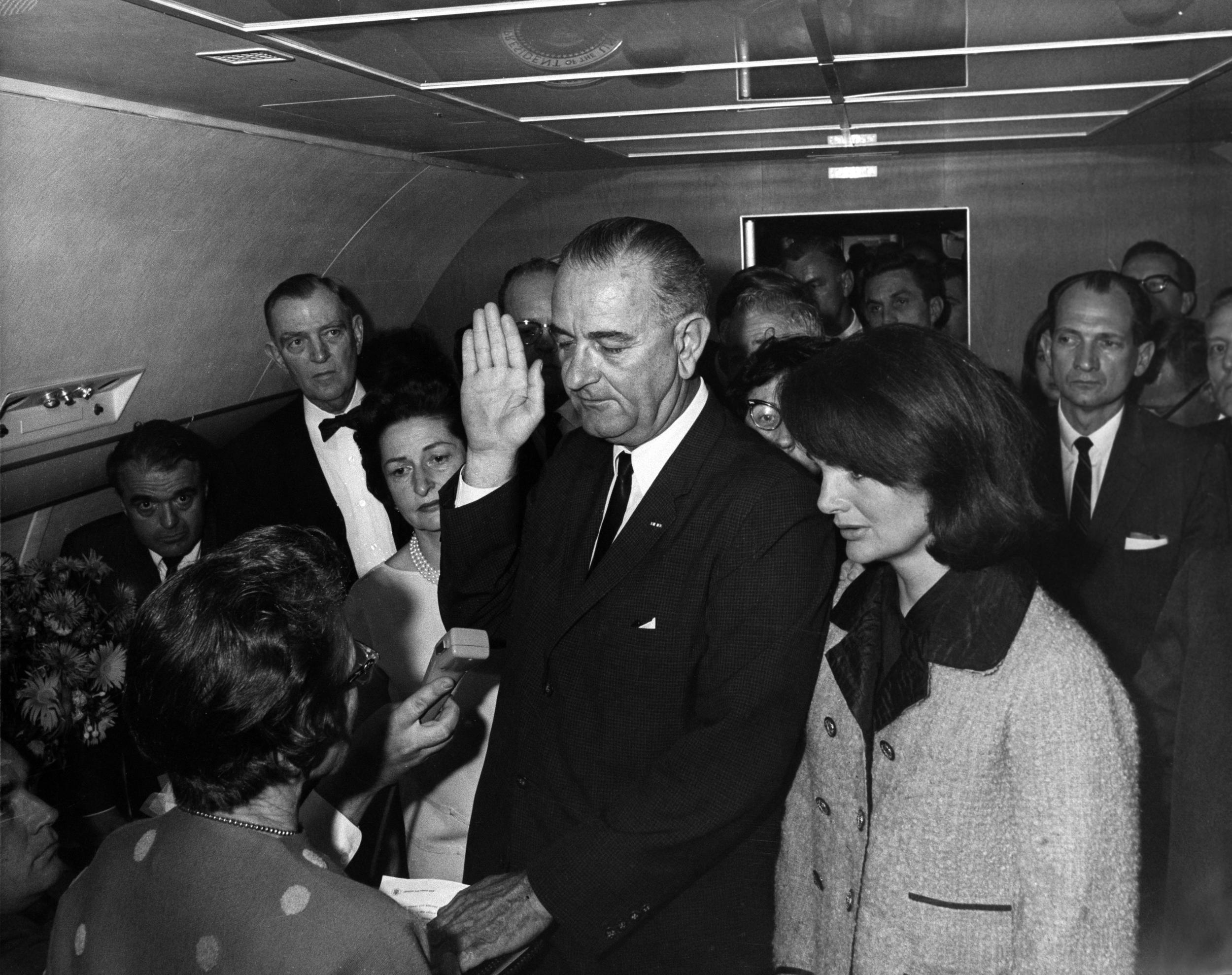 <em>Lyndon Johnson sworn in as president on Air Force One, Nov. 22, 1963</em>   <em>(Wikimedia Commons/Cecil W. Stoughton)</em>