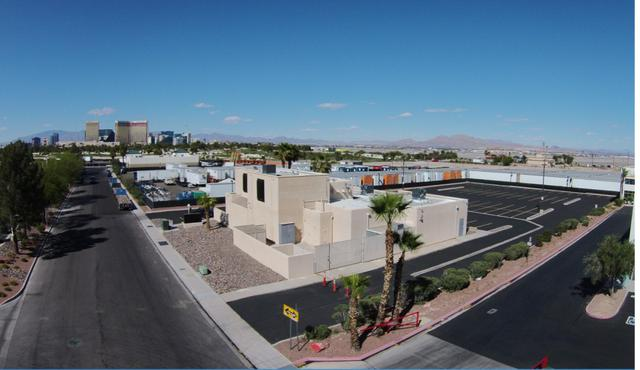 An office building in the corner of an industrial park with the Nevada desert in the background. High net worth real estate investing is about finding opportunities like this where you can.