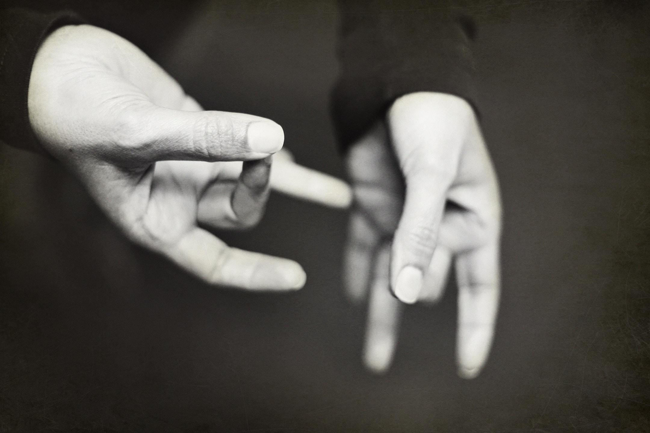 a pair of hands doing american sign language