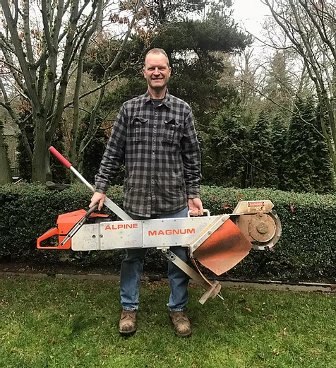 holding the complex stump removal grinder for hard to reach areas