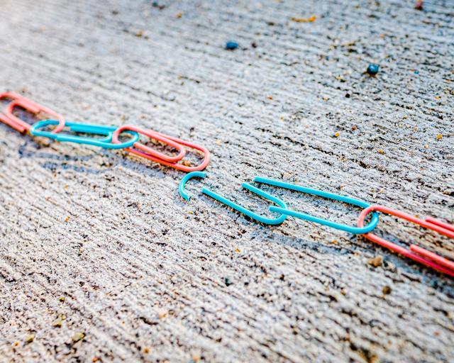 Photo of broken paperclip link representing a couple using a divorce attonrey in San Antonio.