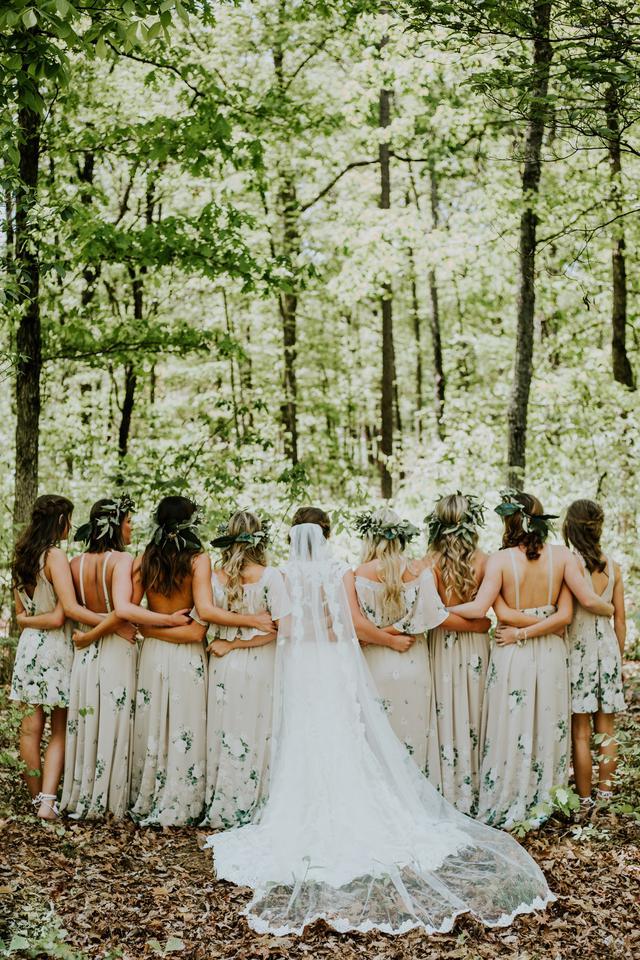nine women standing at woods