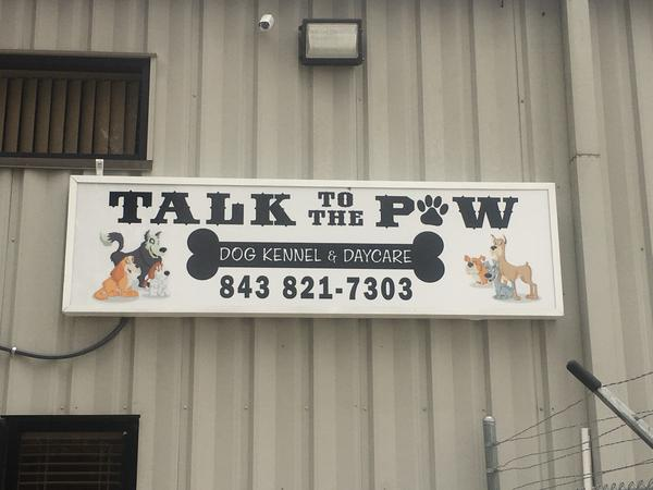 website-review-images/Talk to the Paw Kennel Business Logo Sign out front.jpg