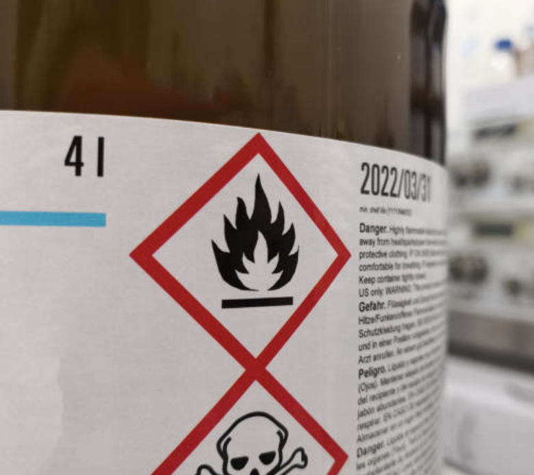 A label signaling hazardous material. Understanding the importance of labeling is just the beginning of what a shipping consultant will help you with.