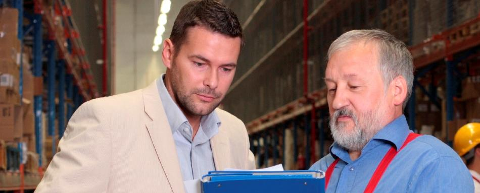 Photo of a hazmat shipping consultant giving advice to a businessman.