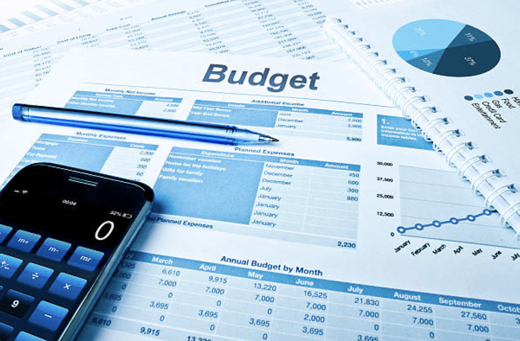 image of budget sheet and other financial documents laid out on a surface