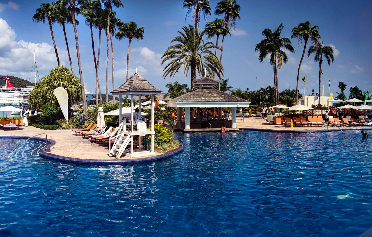 Vacationers swim in and lounge around a pool at Moon Palace Resort In Jamaica.