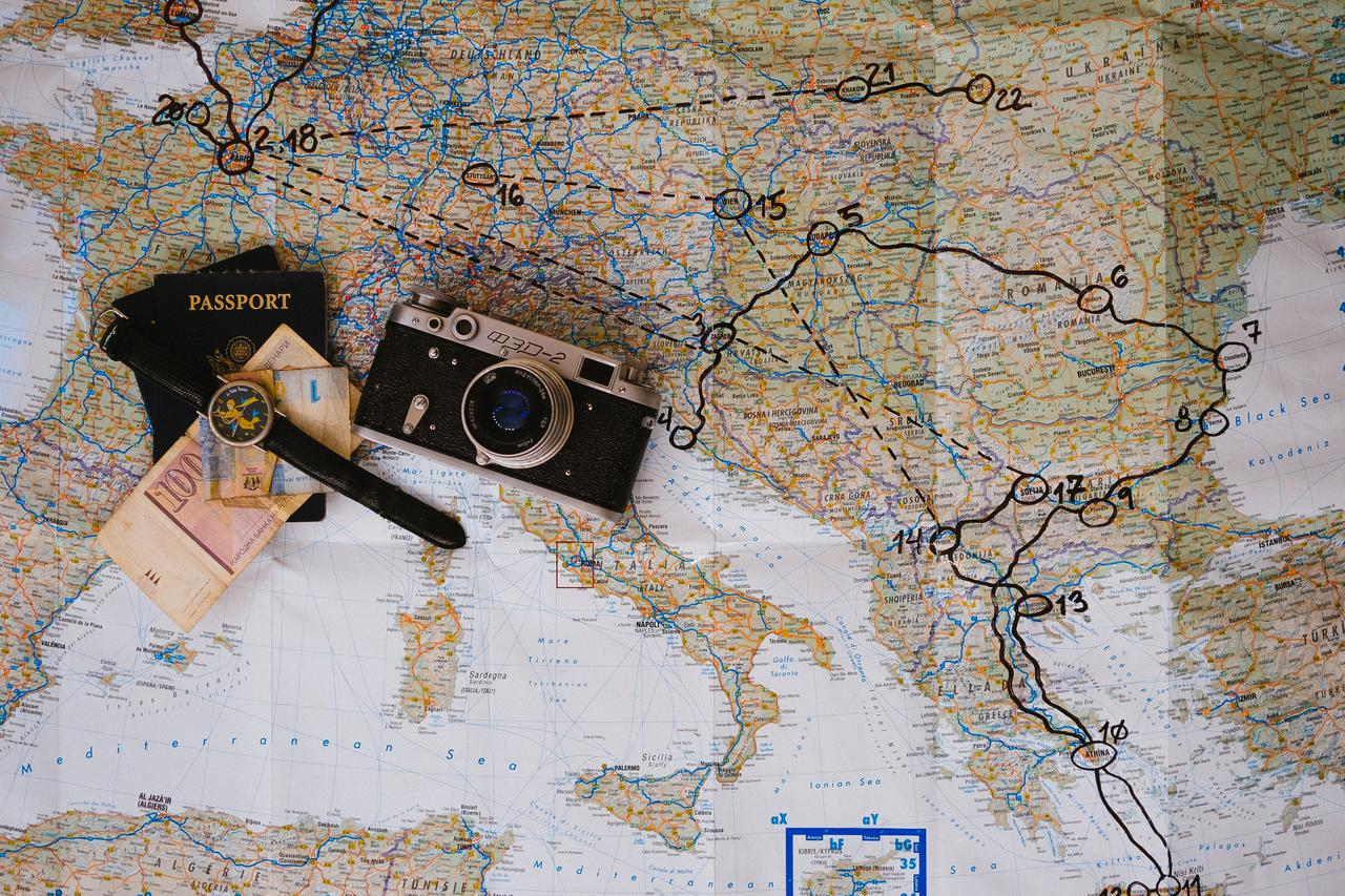 black and gray SLR camera on map