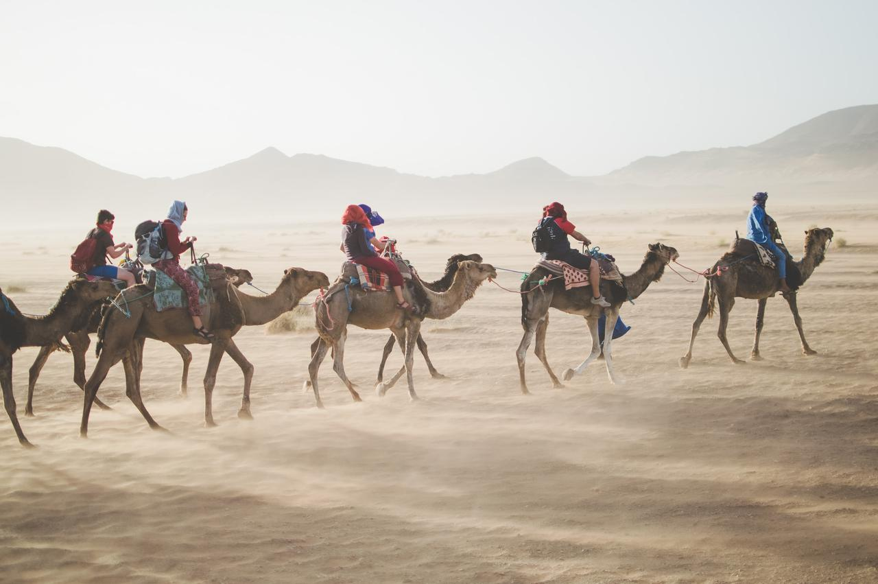 Camel riders in Morocco desert