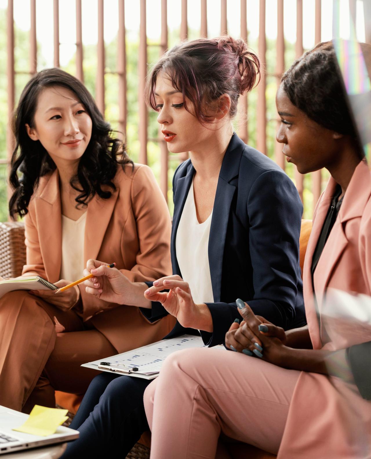 close-up-woman-leading-team-meeting.jpg