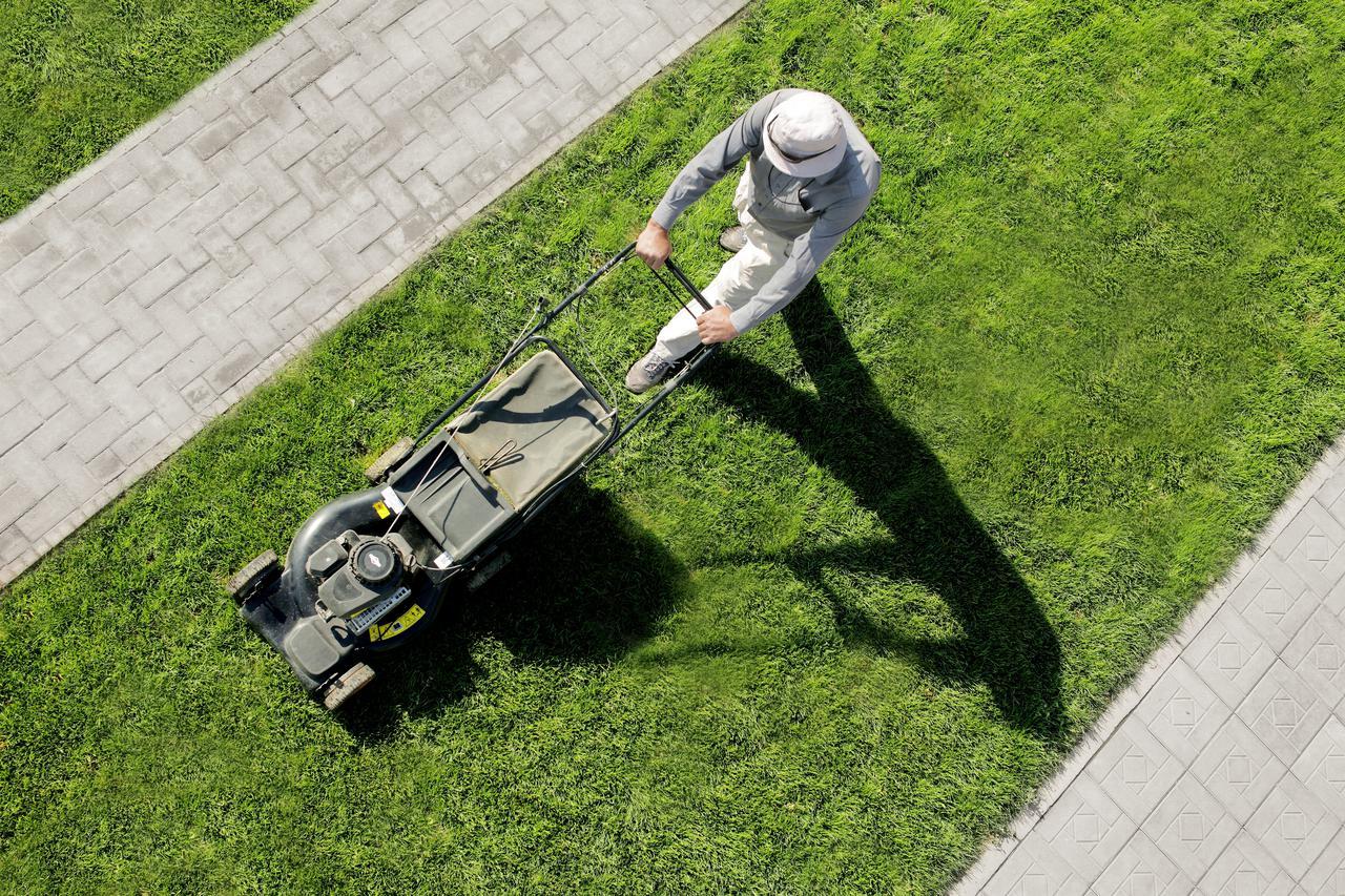 man-is-cutting-lawn.jpg