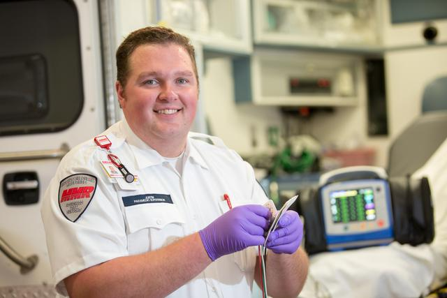 An EMT working. OUr 5-week EMT course will put you on the fast-track to success!