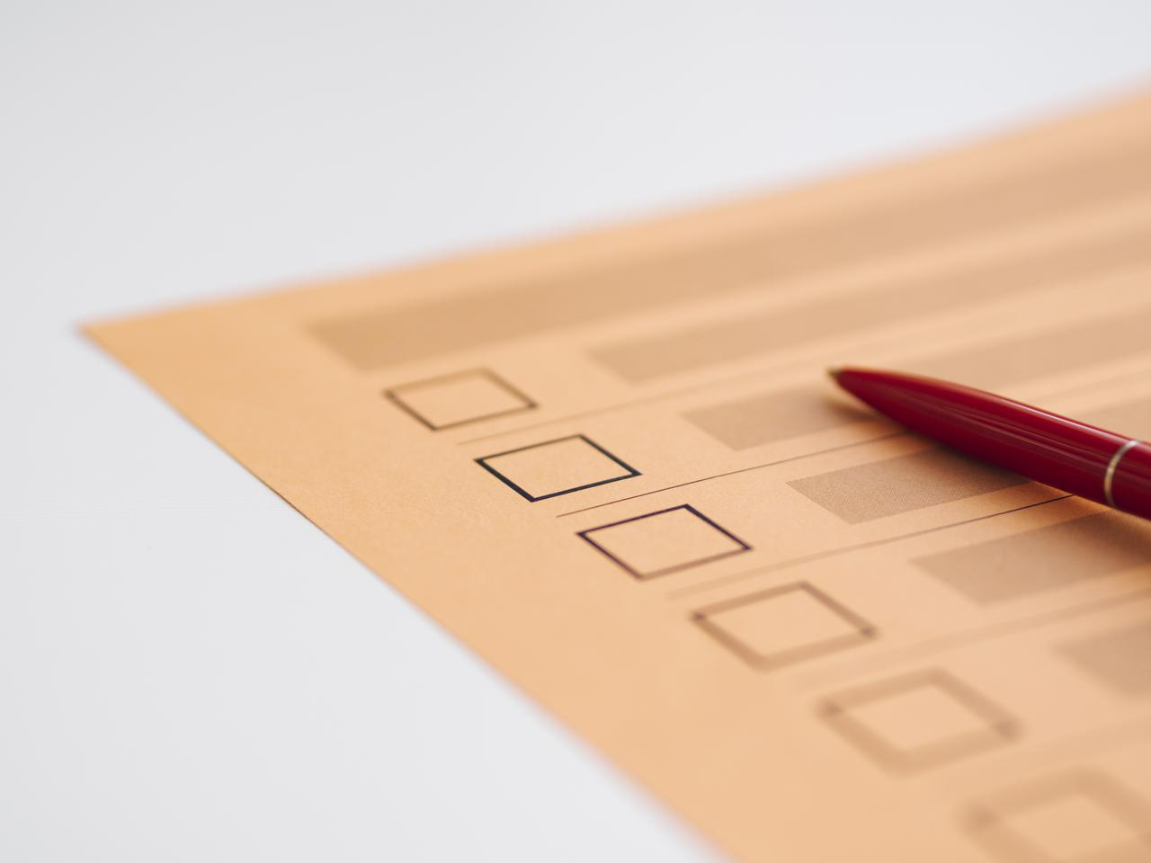 high-angle-uncompleted-voting-questionnaire-close-up.jpg