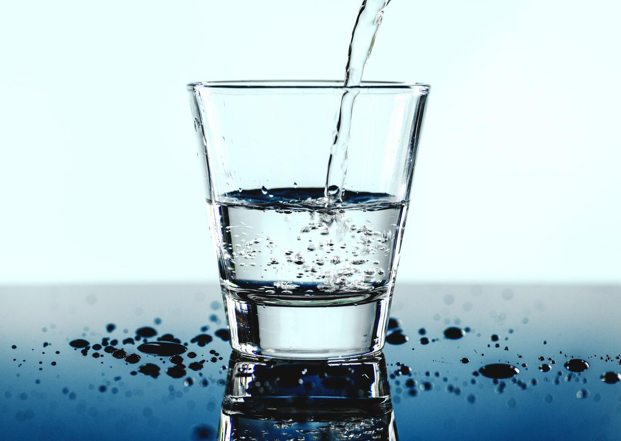 dropped water in clear drinking glass