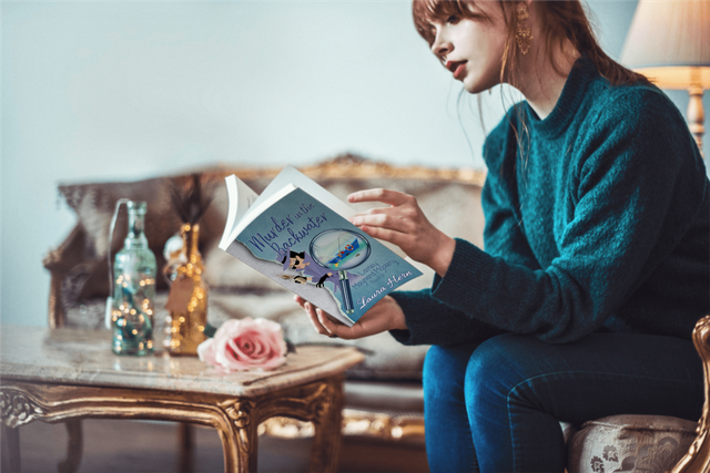 Girl reading in front room - backwater.png