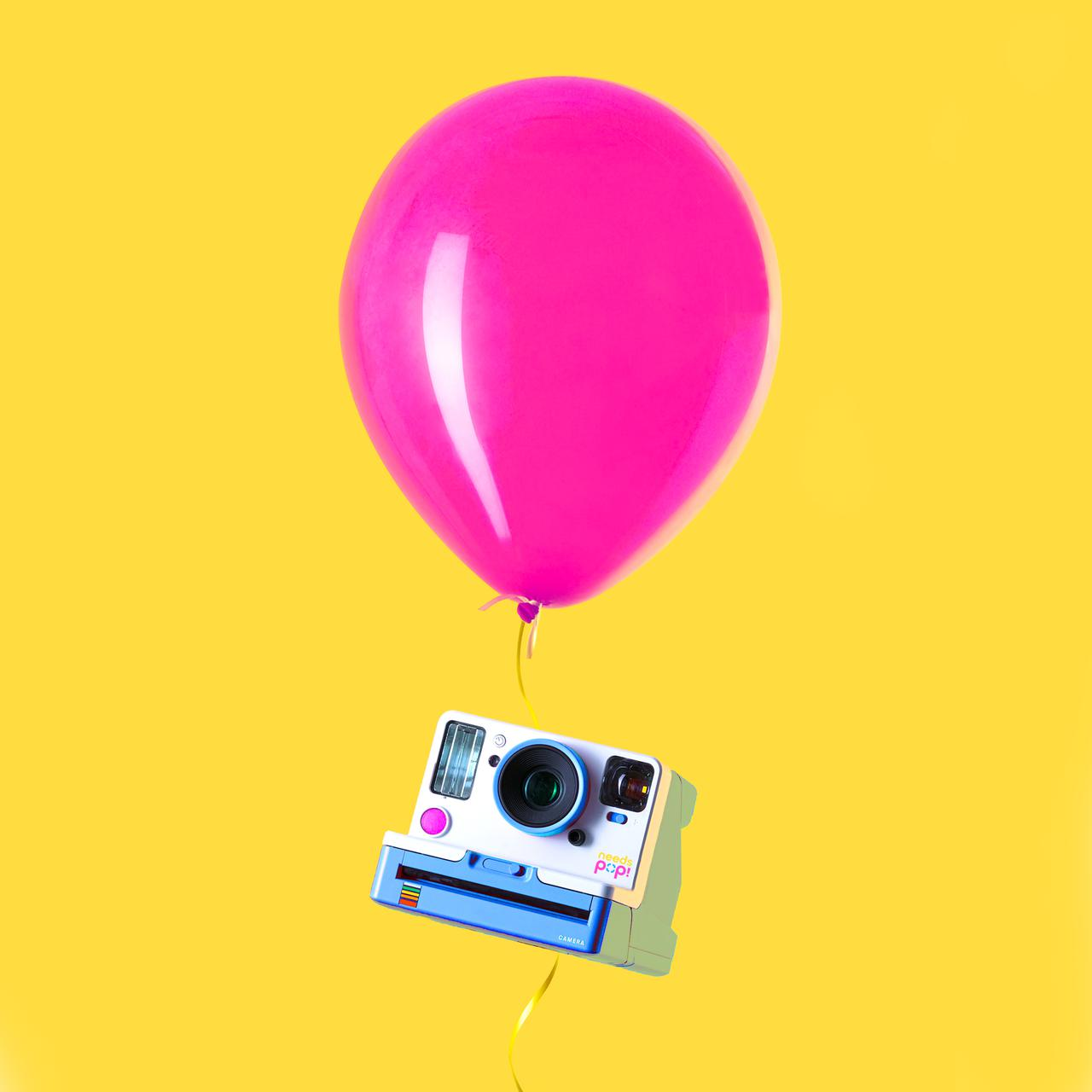 creative of camera and balloon by needs pop! from social media agency growthbuster