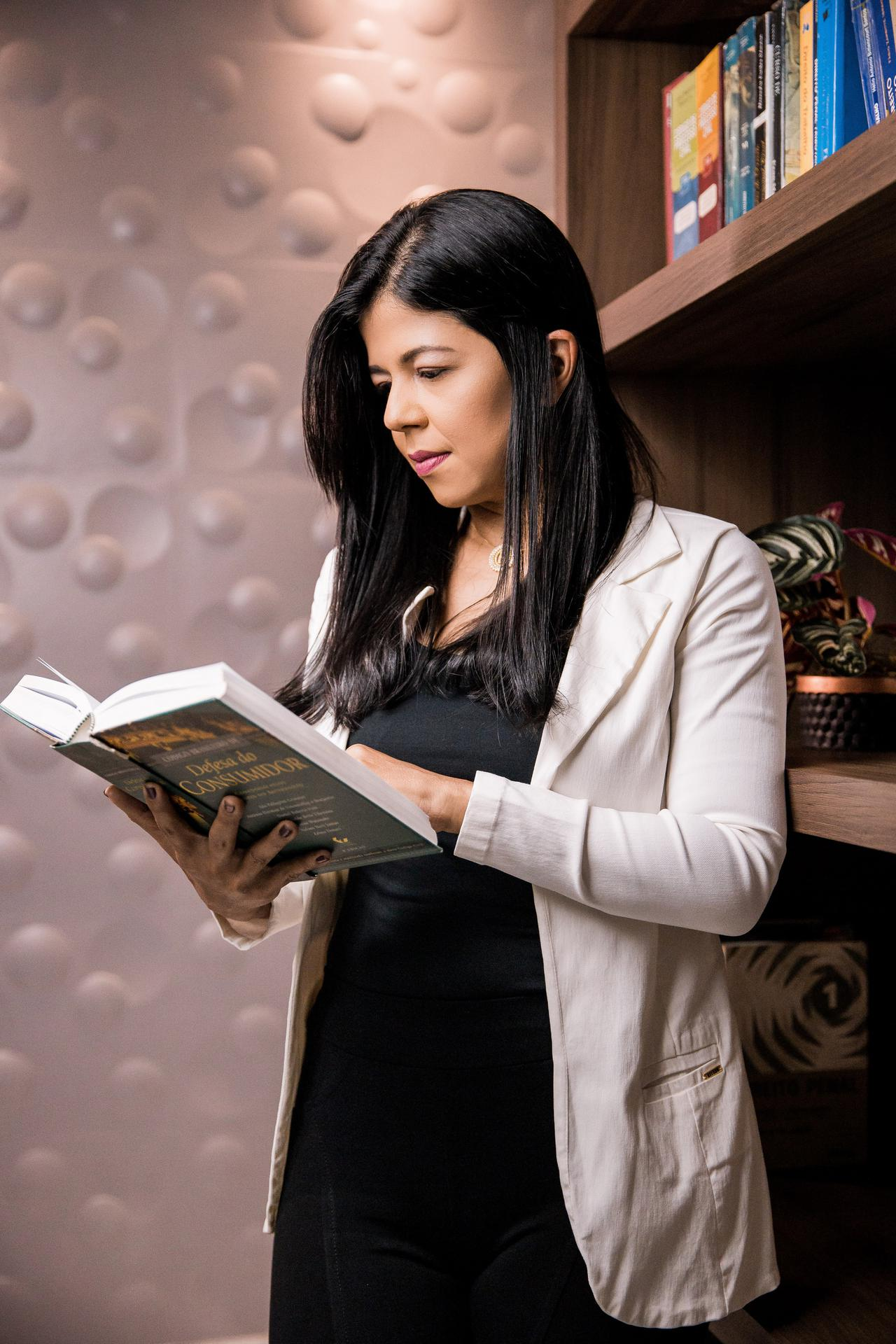 A woman reading a bok in a library. Educating yourself and informing your Sacramento DUI defense attorney is your best route to success in the courtroom.