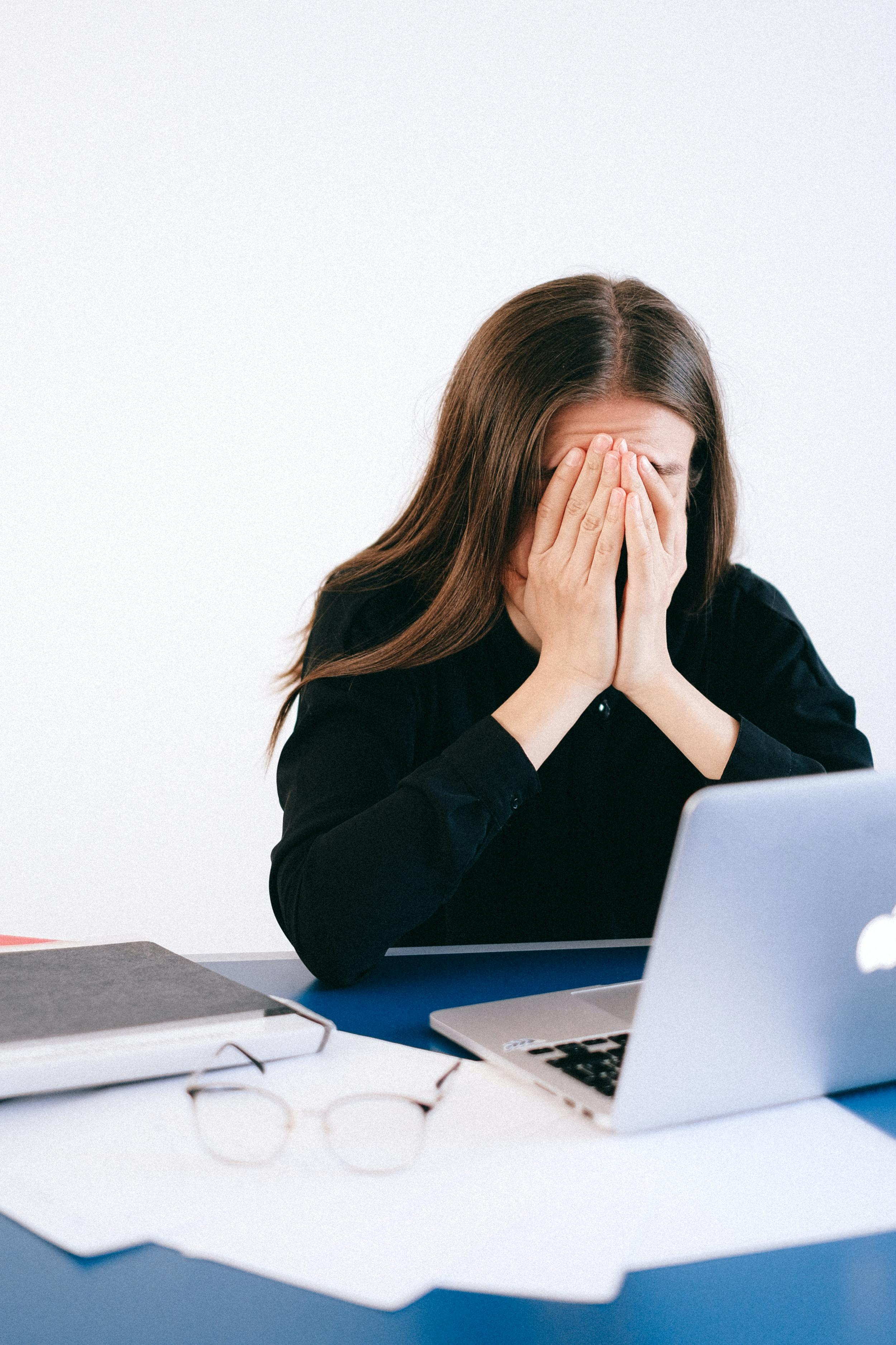 stressed-woman-covering-her-face-with-her-hands-4226221.jpg