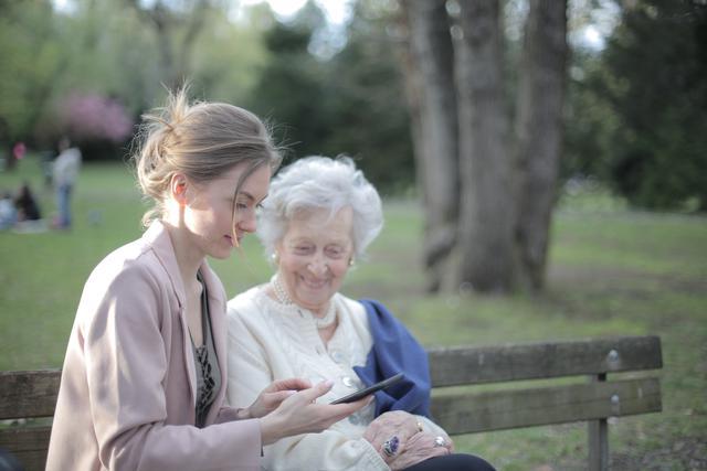daughter-explaining-elderly-mother-how-using-smartphone-3791666.jpg