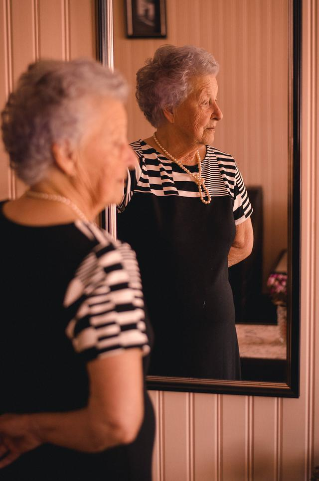photo-of-woman-standing-in-front-of-mirror-2269726.jpg