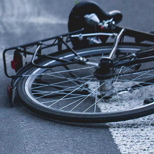 bike laying on the ground as if it's been in an accident