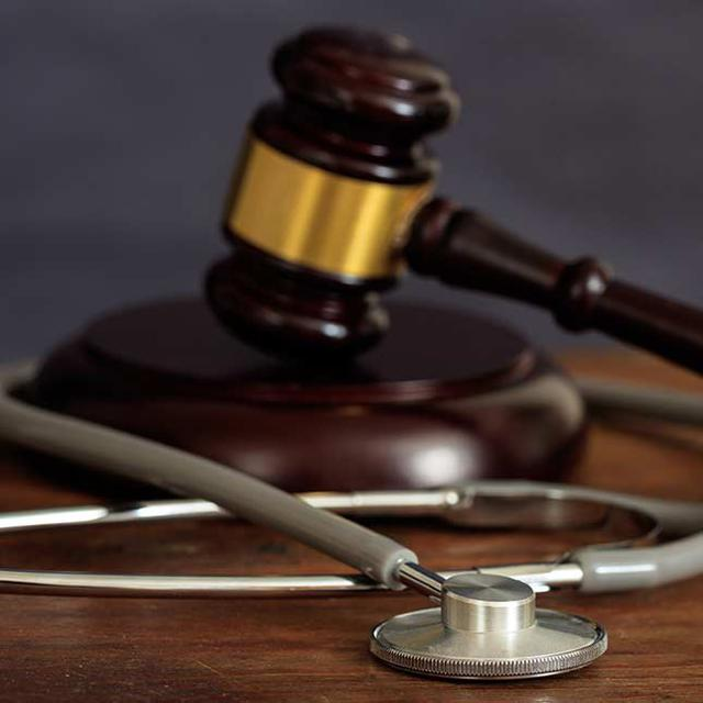 gavel and a stethoscope representing negligent personal injury law services