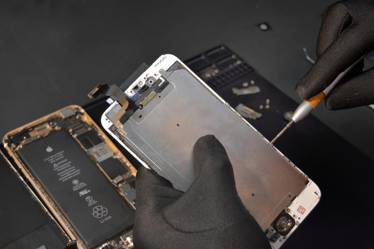 person fixing phone