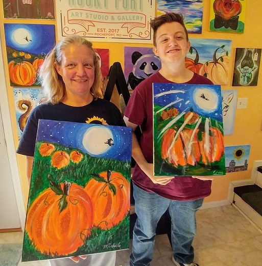 mother son - pumpkin painting