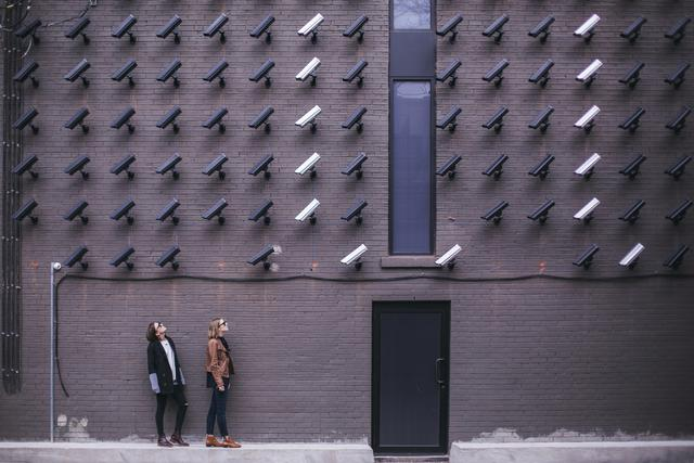 Women looking at a wall of security cameras. With Verkanda camera installation, you'll guaranteed unmatched security solutions for your restaurant.