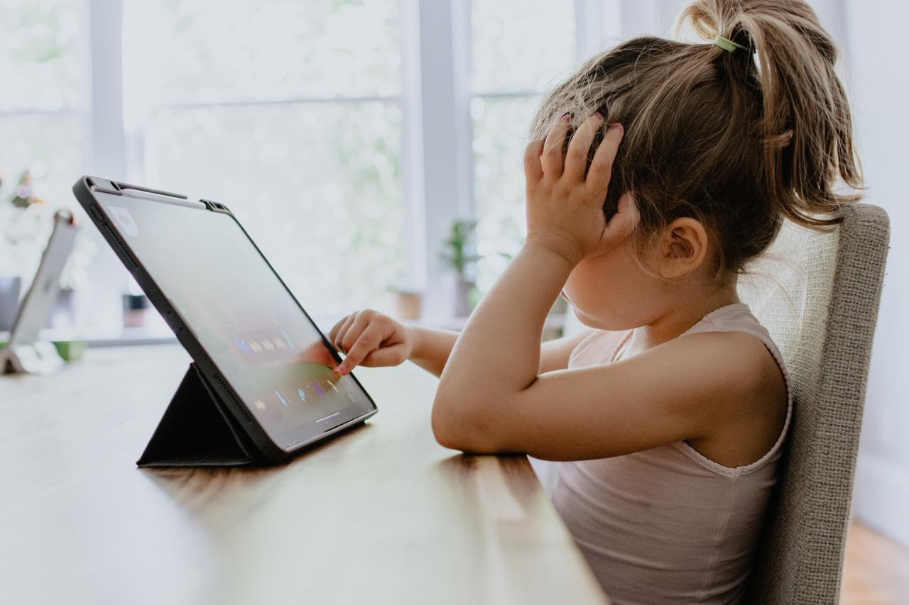 Young girl practicing kids coding on iPad