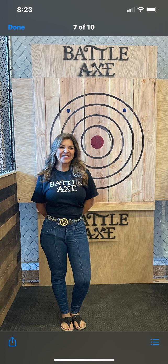 A woman smiling in front of the target.