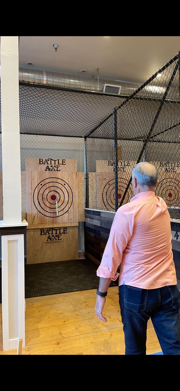 Man hits a bullseye with his ax.