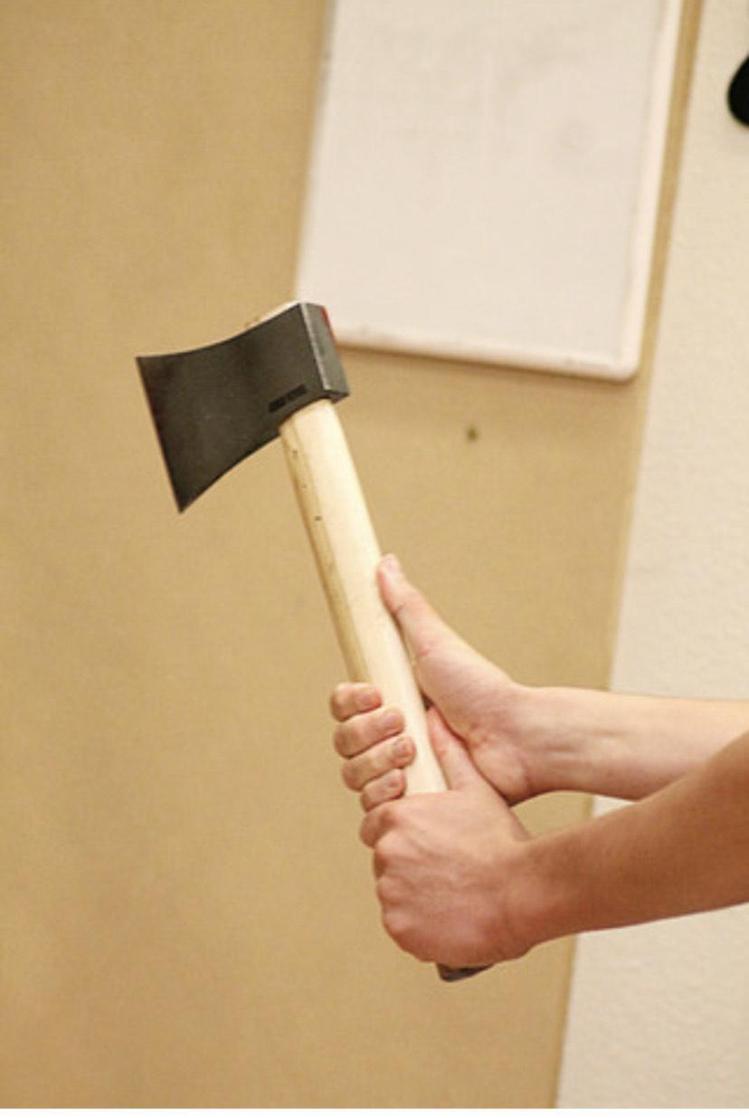 A man holding his ax.