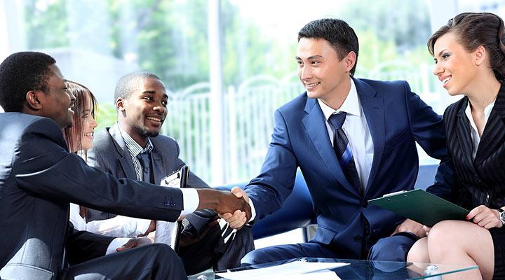 work-doing-business-overseas-meeting-handshake.jpg