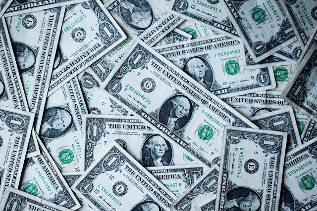A collection of US Dollar bills make an interesting financial wallpaper.