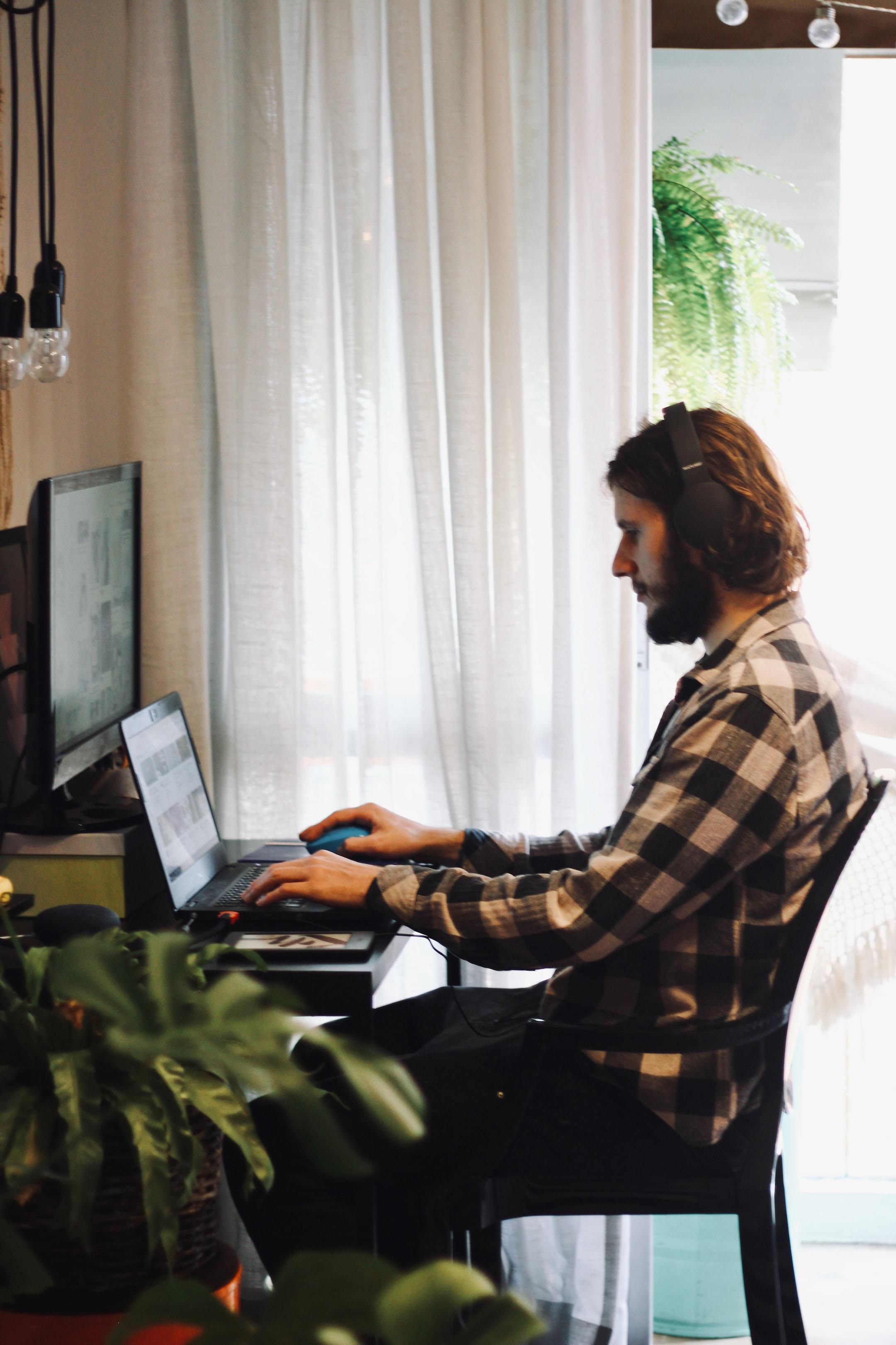 Photo of a man working from home and making money selling promotional products.